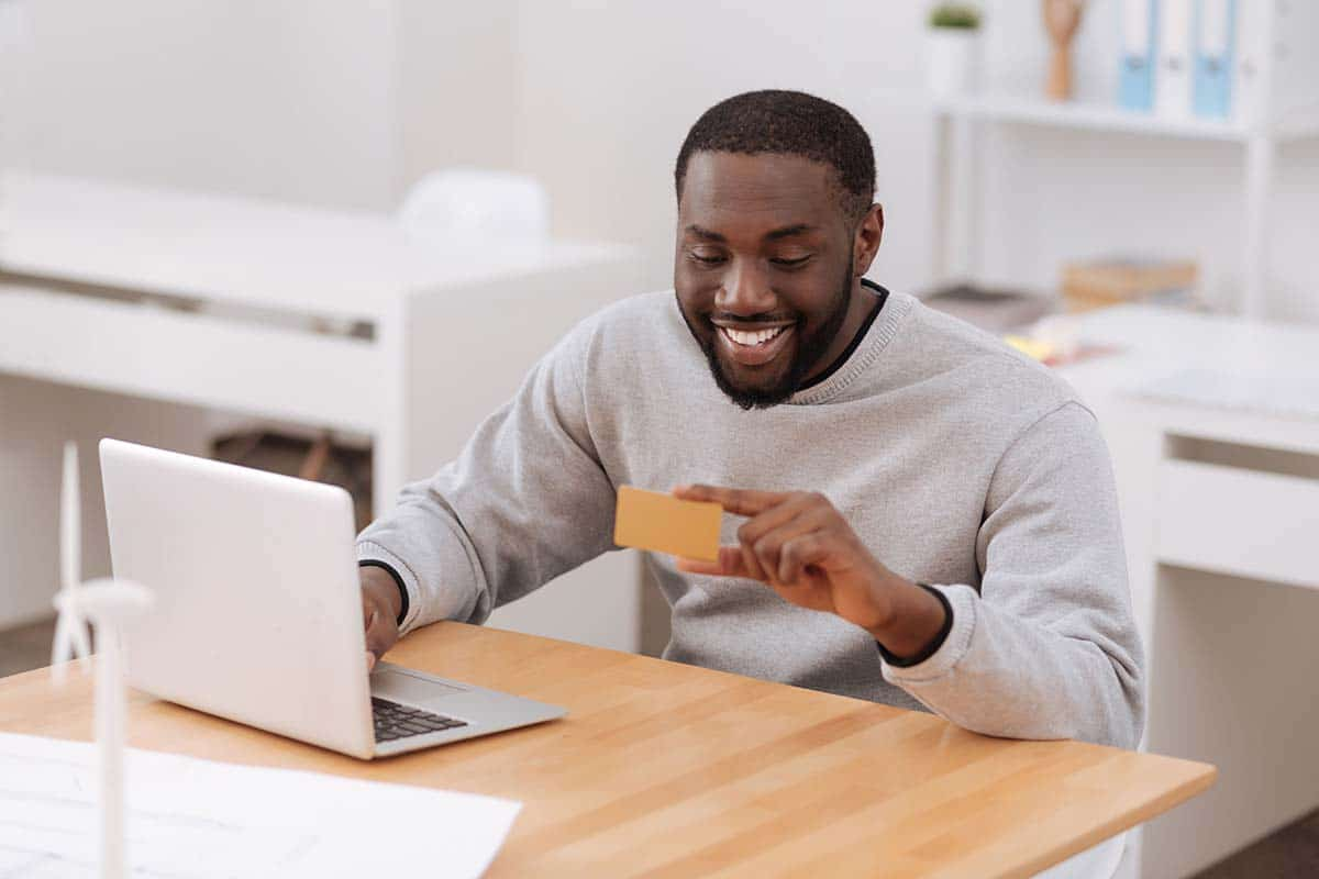 Man looking on a credit card. Best metal credit cards.